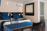 el gran chaparral guesthouse room blue lagoon bed